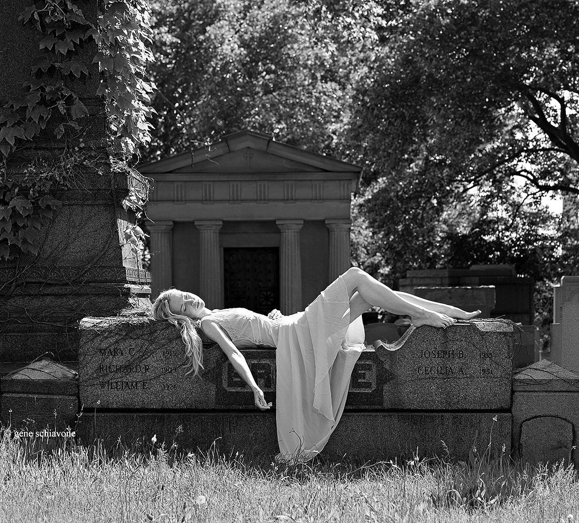 Nap in on a tombstone