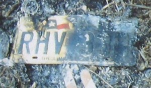 The license plate to Regina's burned Jeep.
