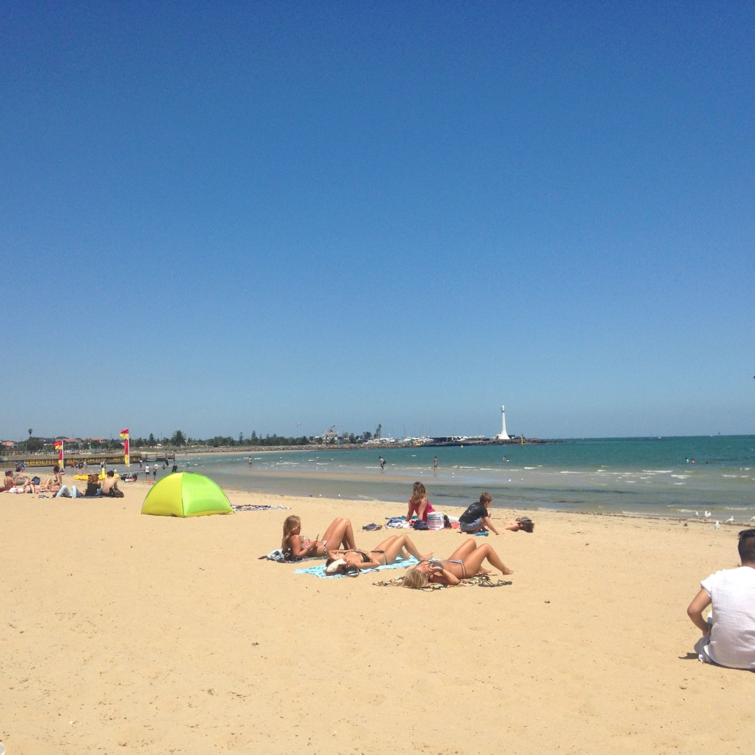 Views of St Kilda Beach on a sunny day with blue skies and golden sand
