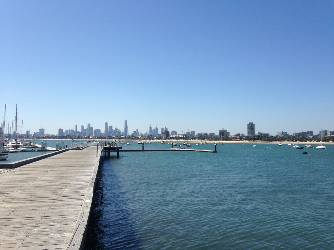 Blue skies and still ocean waters from St Kilda Pier overlooking the city of Melbourne