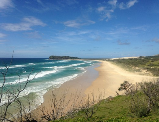 75 Mile Beach on a sunny day with the crashing waves on Fraser Island, Australia