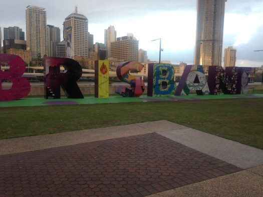 Cloudy skies over the Brisbane southbank where the city's name creates a large outdoor art piece