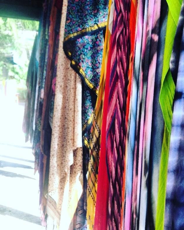 Brightly coloured fabrics hang along the street in Nimbin, Australia