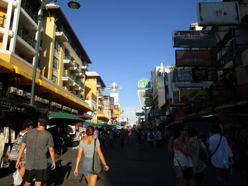 The bustling backpacker street of Koh San Road on a sunny day