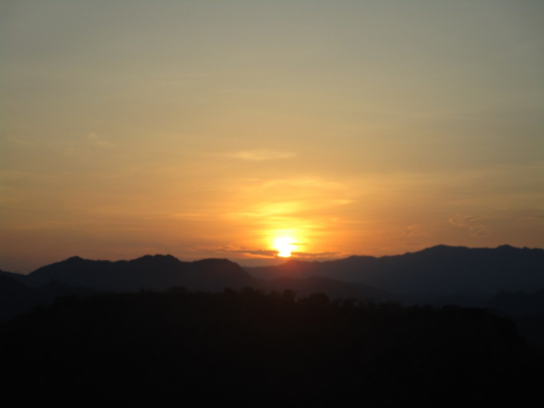 Golden sunset over the moutains of Laos