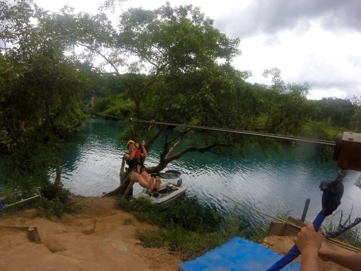 Ziplining across the river to reach the cave entrance
