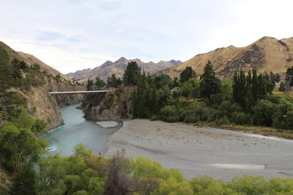 Bridge over a braided river in a mountain valley