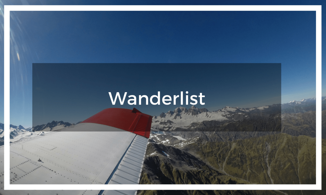 Text overlay a plane wing flying above the glaciers and mountains in New Zealand on a summer's day