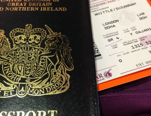 british passport and plane ticket close up