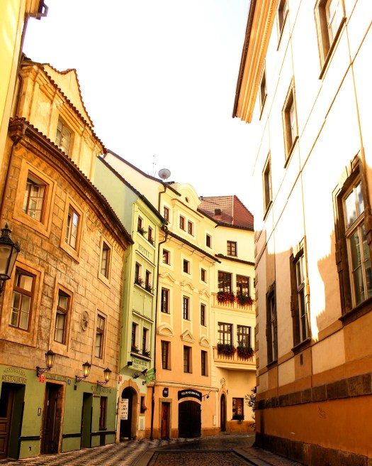 Pastel coloured buildings and gothic architecture around Prague Old City.