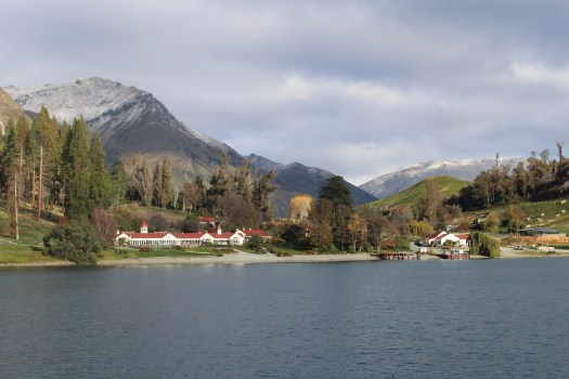 Small farm settlement sits beneath the mountains next to Lake Wakatipu
