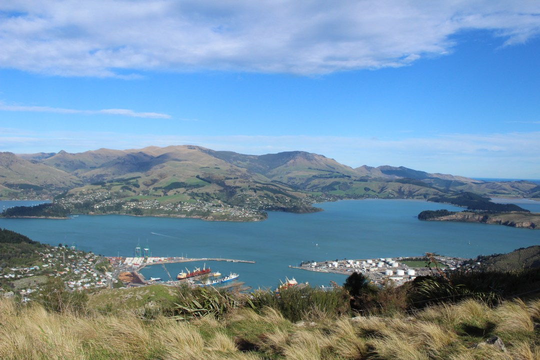 View over bay with small port town in forefront in Christchurch