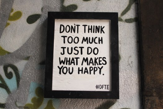 """Street art reads: """"don't think too much just do what makes you happy"""" in Bristol"""