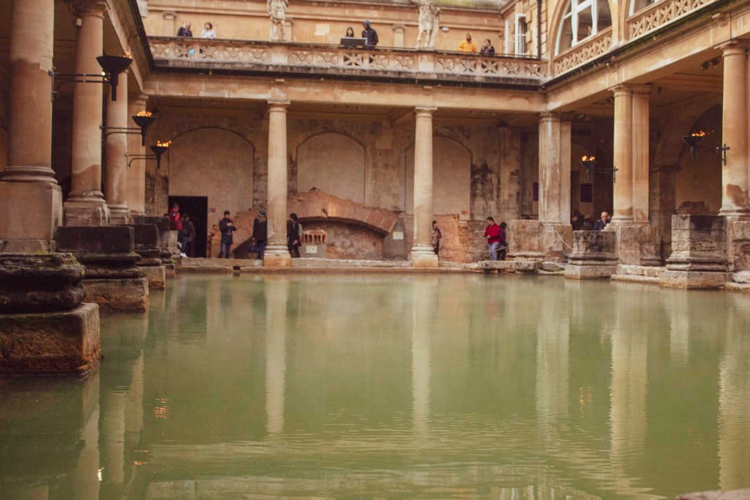 Steam sits atop green Roman Bath waters