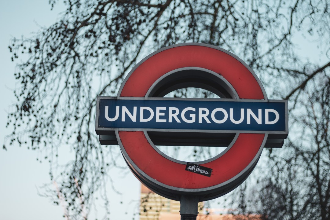 Things To Know When Moving To London - A London Underground sign, but it's better to walk or catch the bus to get the best transport in London!