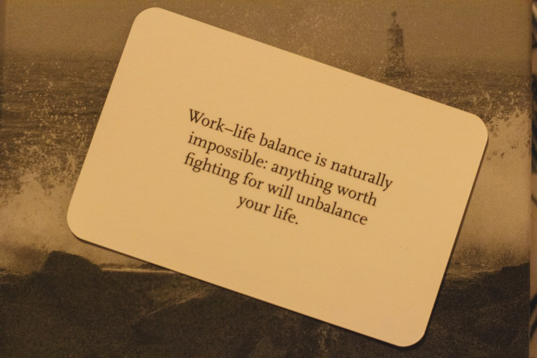 Motivational message about work-life balance on small card