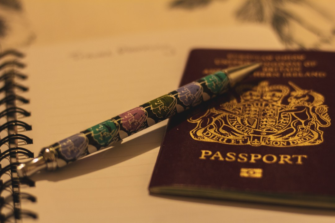 Pen and passport on notepad