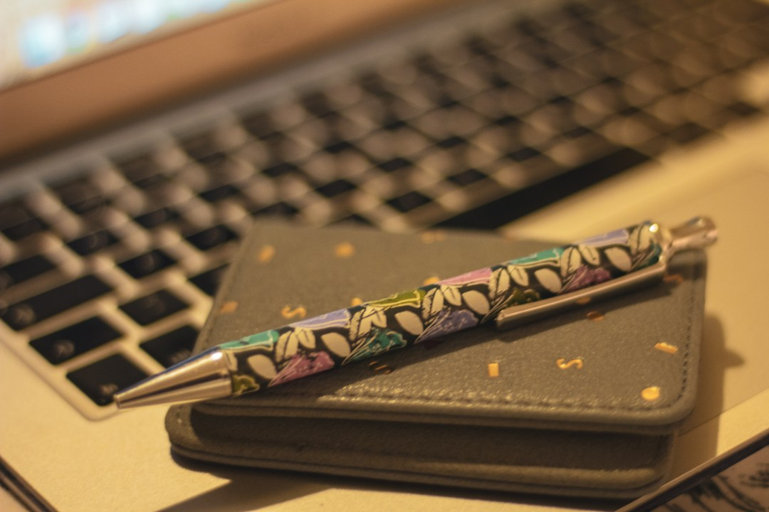 Pen and purse on keyboard