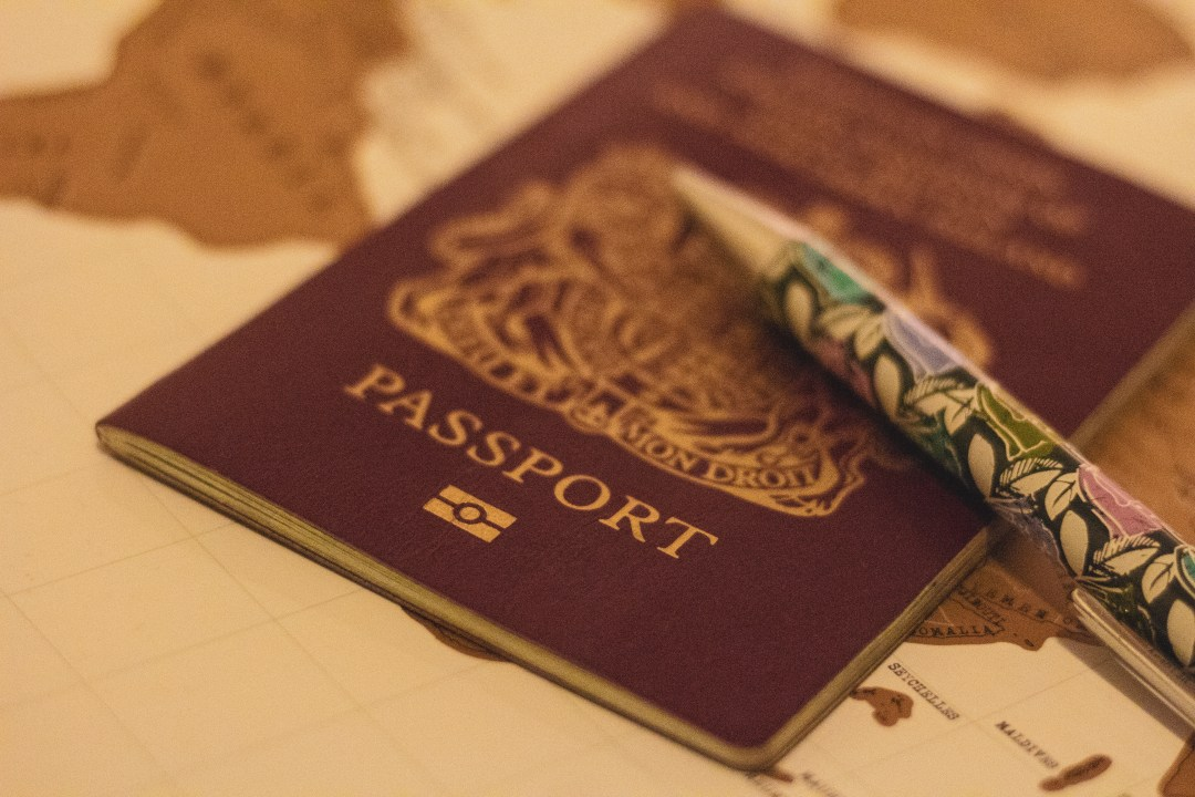 Close up passport with pen and map
