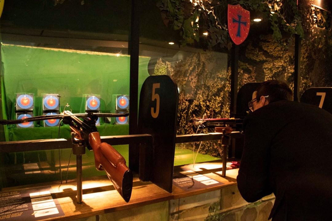 Man shoots crossbow at target