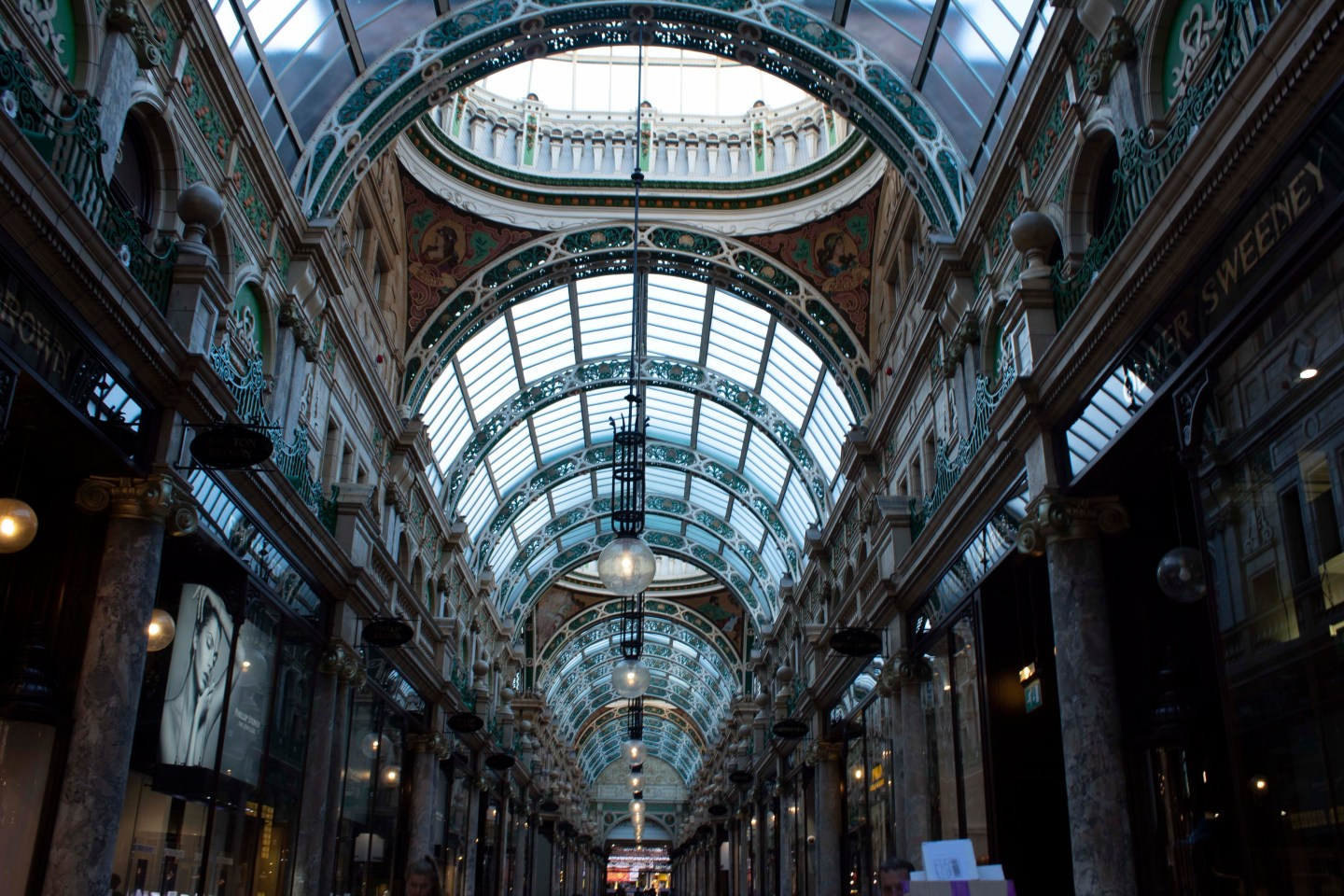 Arches and marble pillars inside a Leeds shopping arcade