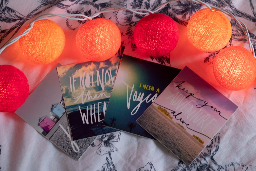 motivational quote cards on bed with fairy lights