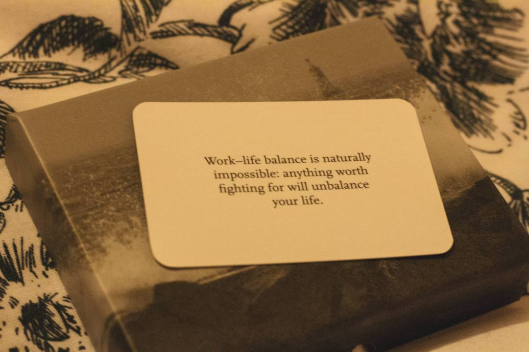 Work-life balance motivational message on a small card