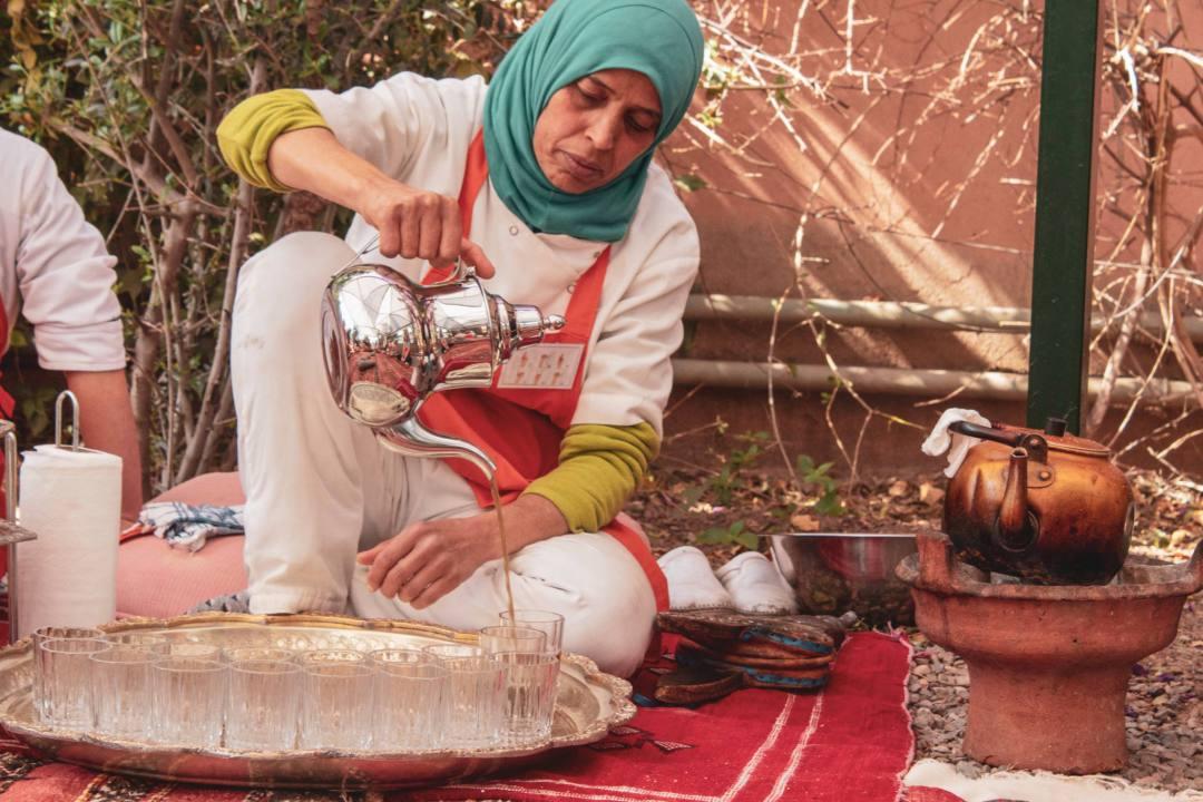 Amal centre trainee pours traditional Moroccan mint tea
