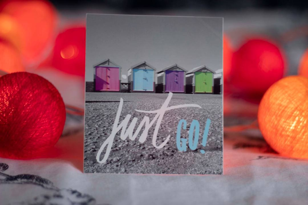 Poster with beach huts surrounded by fairy lights