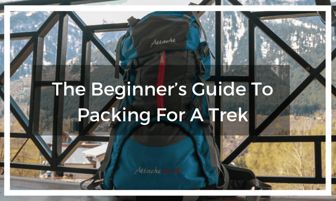 backpack ready for trek sits against a fence with title text overlay
