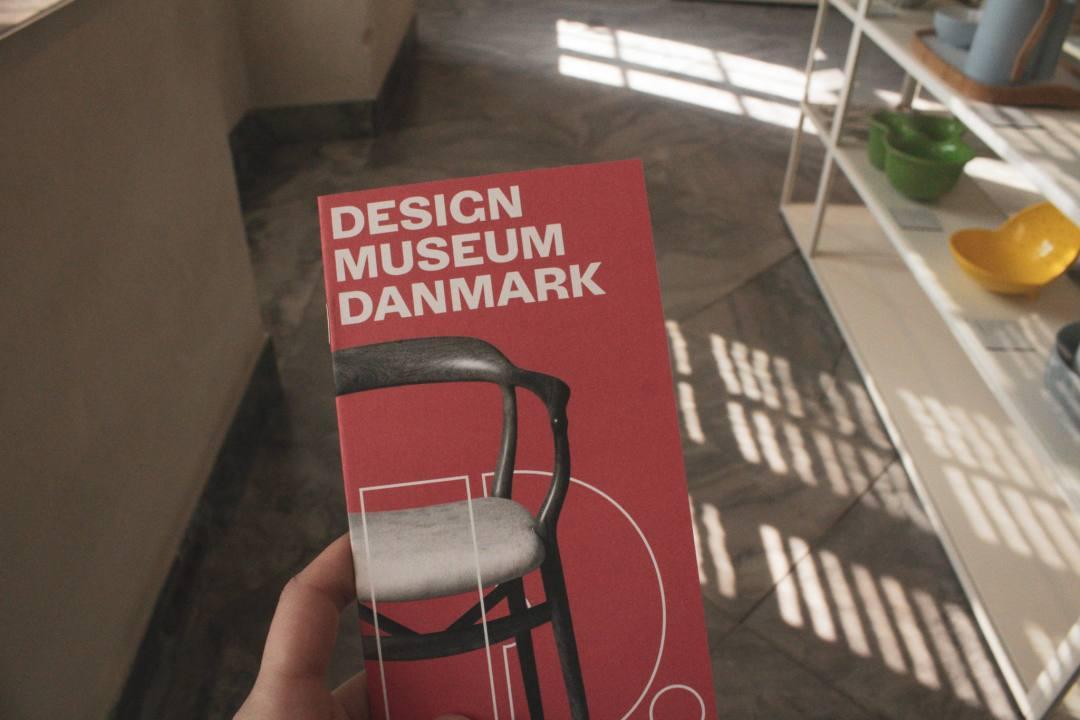 Holding leaflet to Design Museum Danmark in Copenhagen