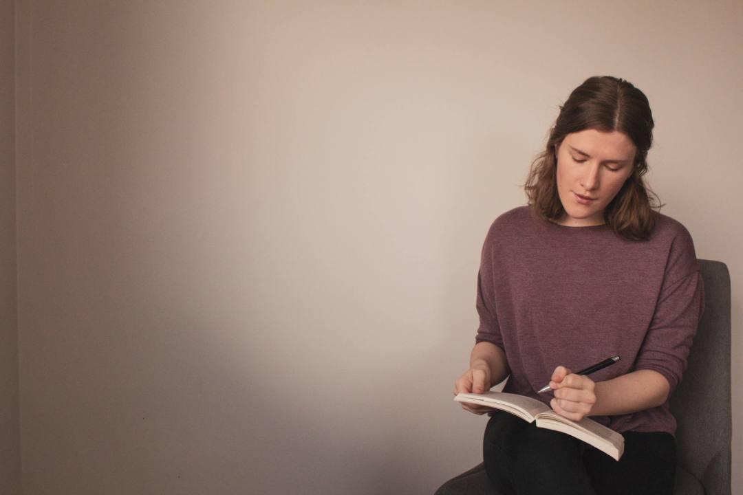 Woman writes in guidebook