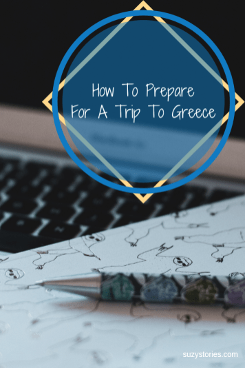 notepad and pen for planning trip to greece