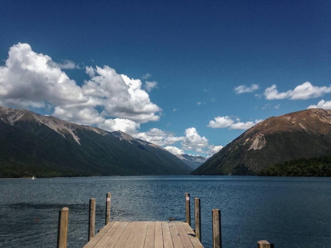 jetty overlooking mountainside lake