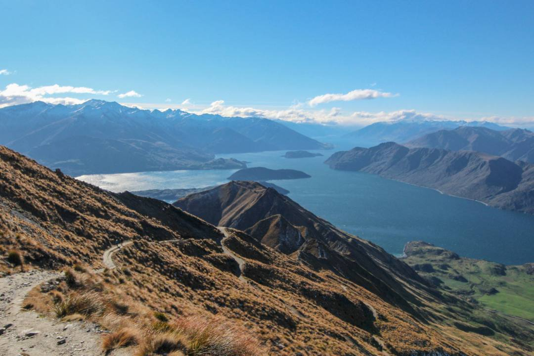 roys peak track from high up the cliffside walk overlooking lake and mountains