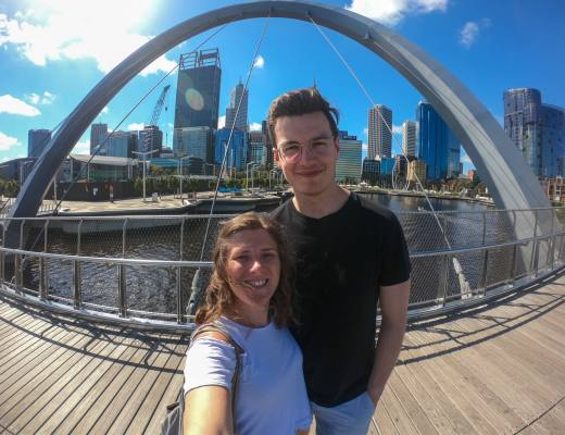 Couple take selfie in front of Perth city