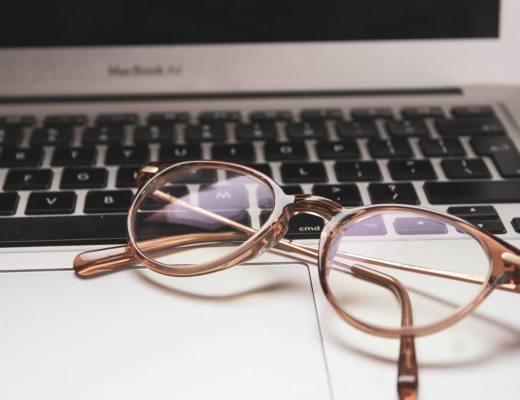 glasses on laptop keyboard