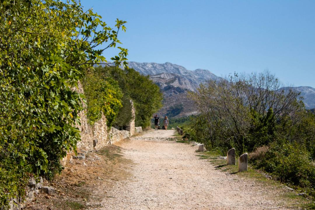 gravel footpath leading to amphitheatre in salona