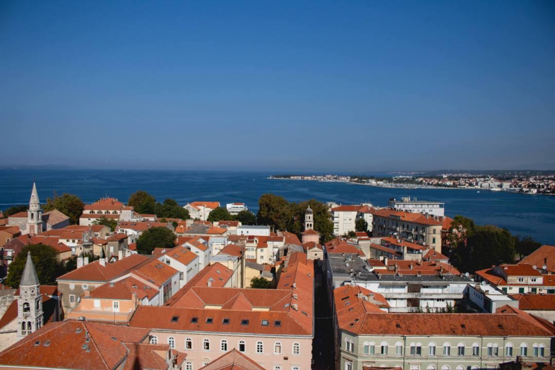 View over ocean and red tiled roofs in zadar