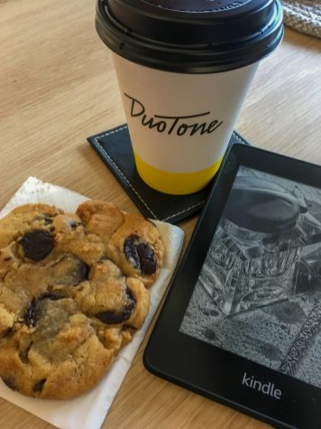 coffee cup and cookie with kindle