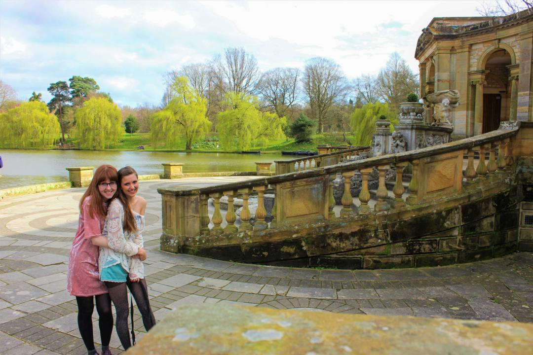 Friends hug while standing in front of Hever Castle