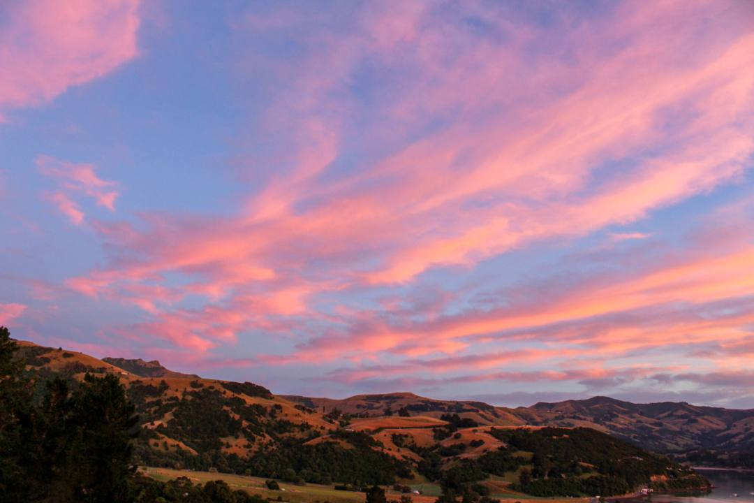 Pink clouds at sunset over Banks Peninsula hills
