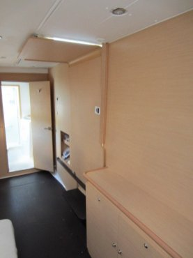 Owner's stateroom looking from bed to head/shower