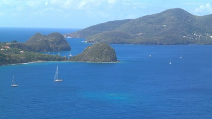 Les Saintes Pain de Sucre (sugar loaf) behind which we hid from the wind with Terre de Bas in the background
