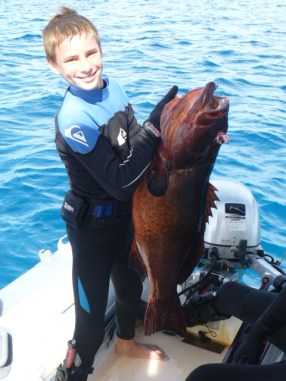 Brendan with 31# Coral Trout Grouper, from s/v Exodus at South Minerva