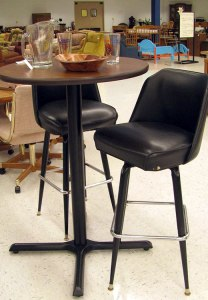 Tall bar stools and table with glasses and pitcher for sale at St. Vincent de Paul's Fond du Lac.