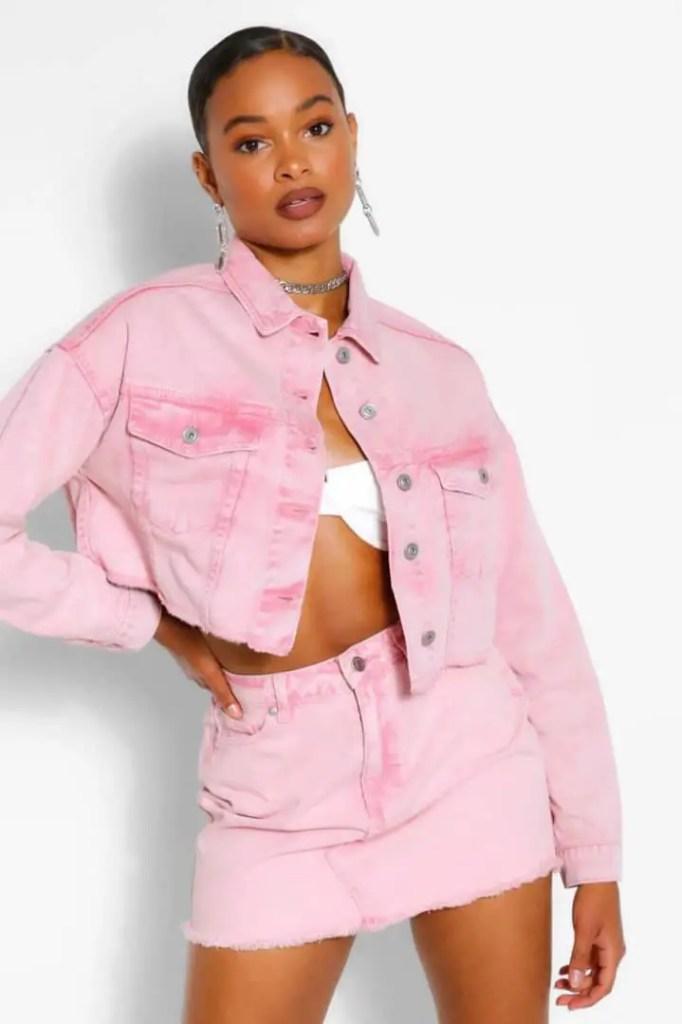 lady wearing pink denim jacket with short denim skirt