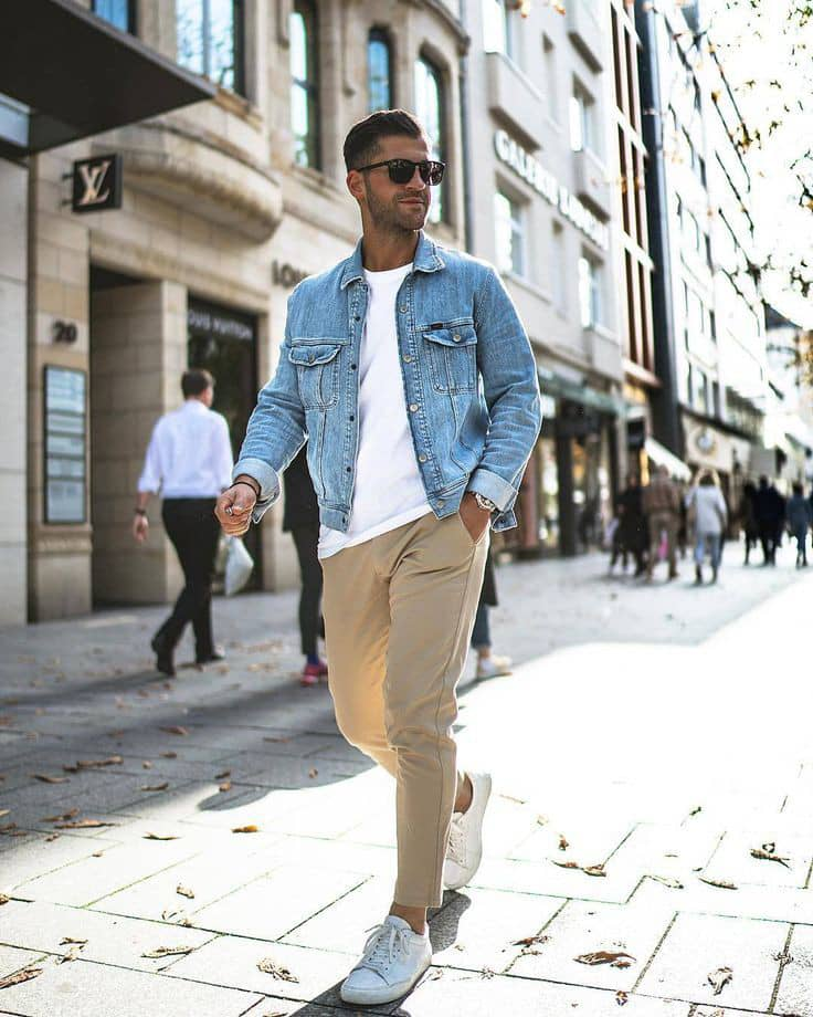 man wearing jean jacket with glasses