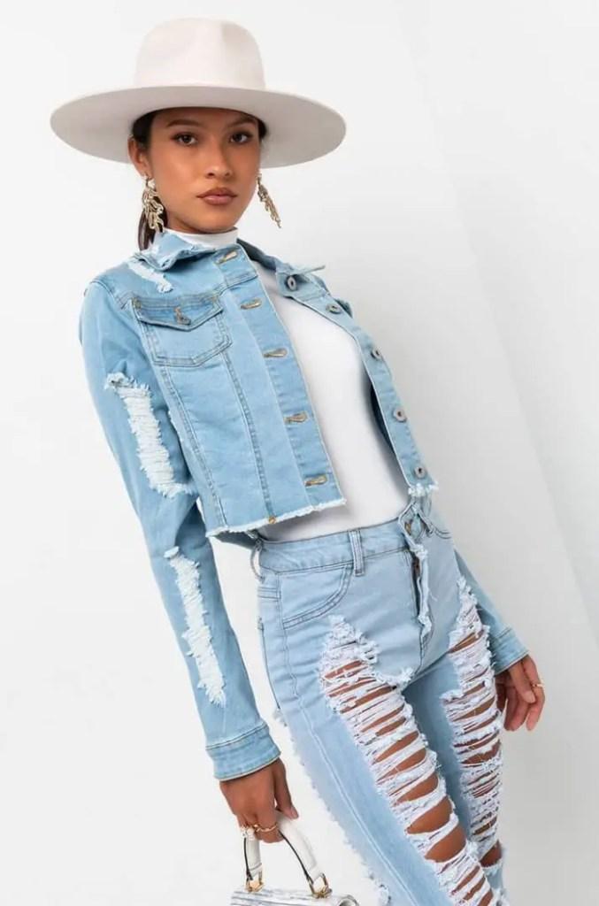 lady rocking jean jacket with hat