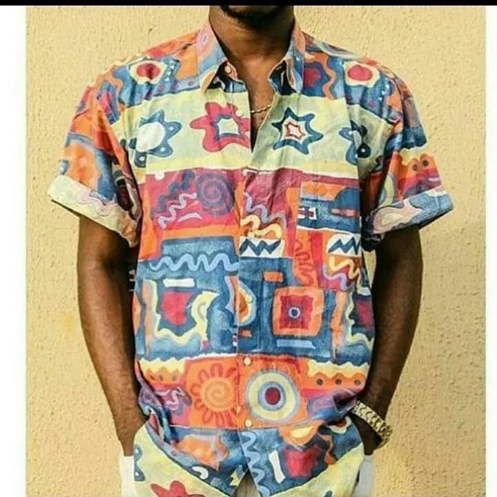 man rocking multi patterned vintage shirt